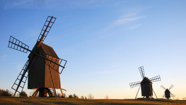 Old wooden windmills in a row at the swedish island Oland, the island of sun and wind